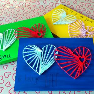 string art hart eindresultaten. Verschillende kleuren verf met andere teksten.